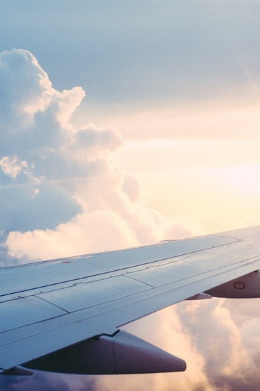 airplane-wing-sky-travel-clouds