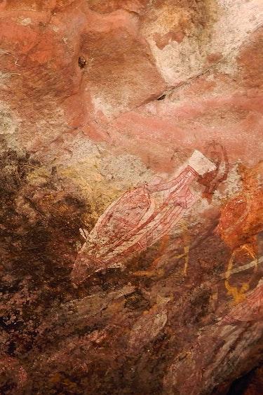 Aboriginal with rock art Fam Plukker
