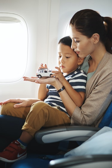 Au cathay pacific mother son family under5s flights economy