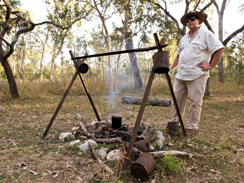 Local Aussie guide, Neil, lights a campfire in the bush