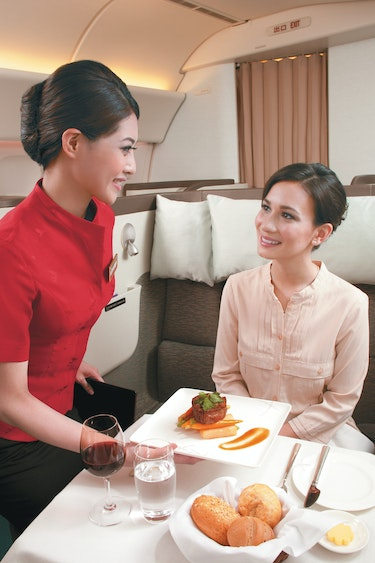 Au cathay pacfic food service partner flights first class