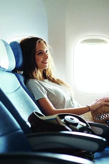 Au cathay pacific girl smiling partner flights premium economy