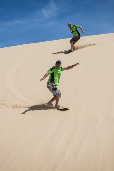 Aus port stephens sandboarding couple partner see and do active