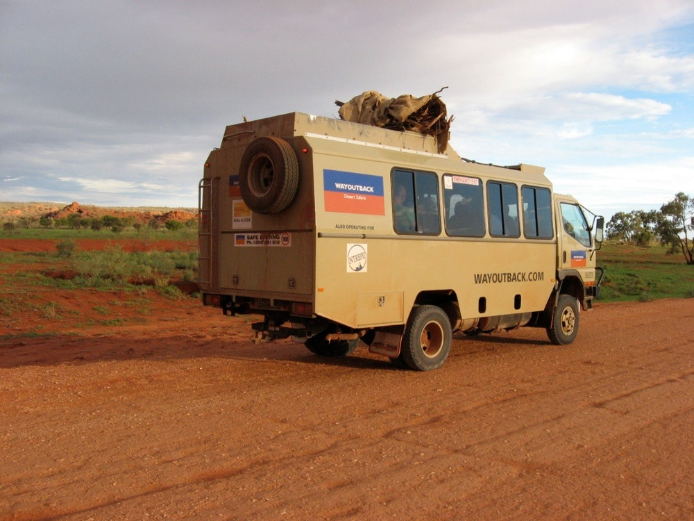 A 4WD truck touring in the Outback