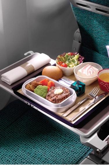 Au cathay pacific meal solo flights premium economy