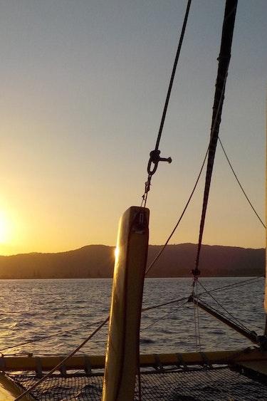 Nz coromandel sail sunset boom sailing