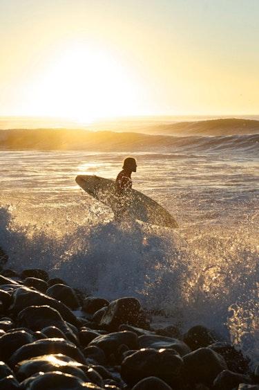 Nz general activities dunedin sunrise surfer water