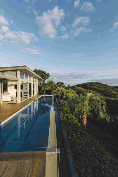 Nz bay of islands villa pool view family stays luxury