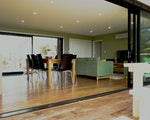 Spacious living room with terrace overlooking the sea | New Zealand holiday with kids