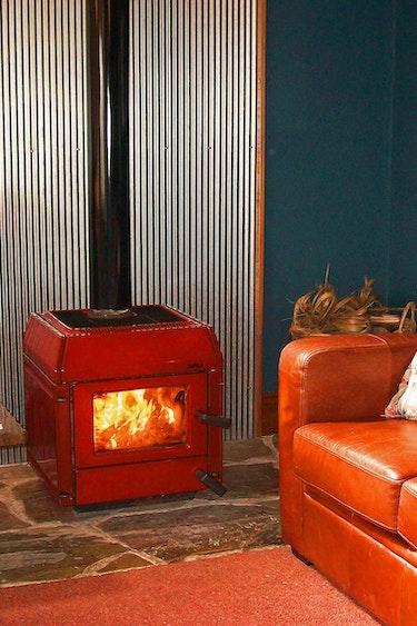 Nz coastal otago kanuka cottage living room fireplace family comfortable