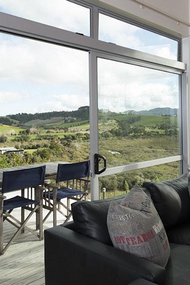 Nz matakana bach livingroom view family stays comfortabl