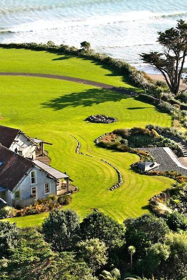 Nz taranaki ahu ahu beach villas aerial family very comfortable