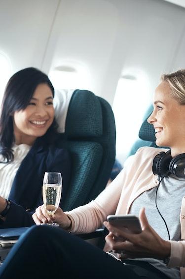 Nz cathay pacific two ladies friends flights premium economy