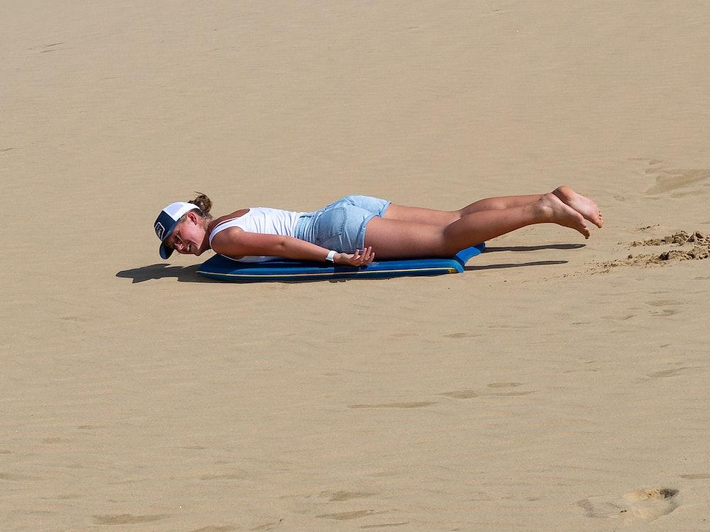 Sandboard down the remote Te Paki dunes