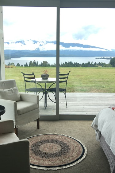 Nz fiordland national park lodge terrace view friends stays very comfortable