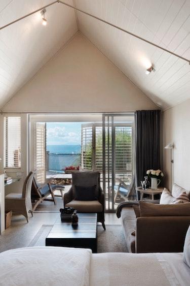 Nz waiheke island lodge bedroom view friends stays luxury