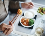 Variety of food options served with vintage wines in Business Class