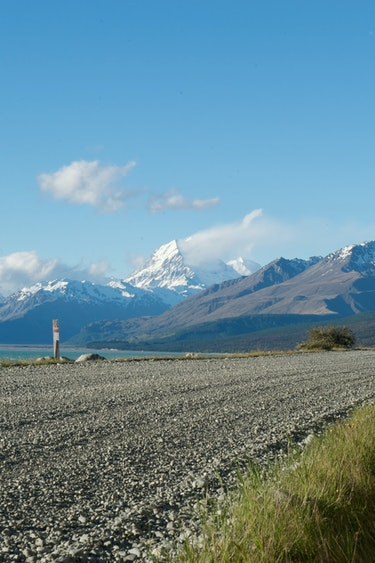Nz lake tekapo road mountains partner compact car