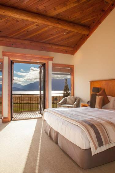Nz fiordland lodge bedroom view solo stays luxury