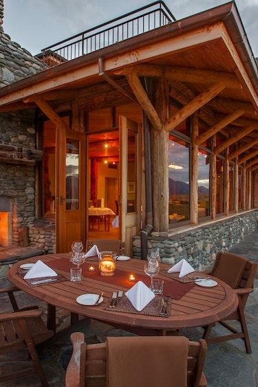 Nz fiordland lodge dining fire solo stays luxury