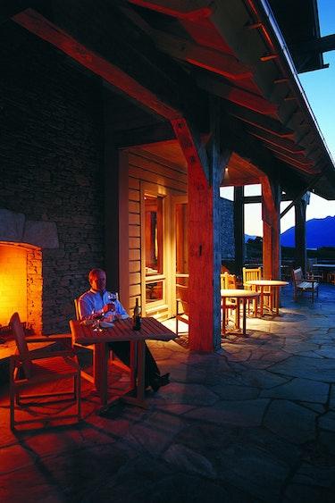 Nz glenorchy lodge terrace wine fireplace solo stays luxury