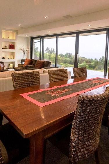 Nz te anau lodge common area living dining stays comfortable