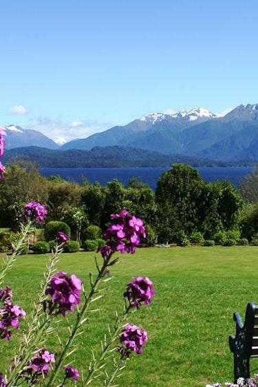 Nz te anau lodge garden view flowers mountain stays comfortable