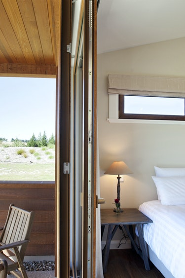 Nz wanaka lodge bedroom patio view solo stays luxury
