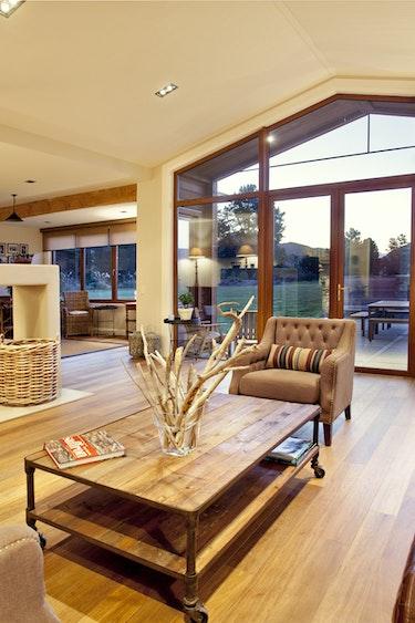Nz wanaka lodge living fireplace view solo stays luxury
