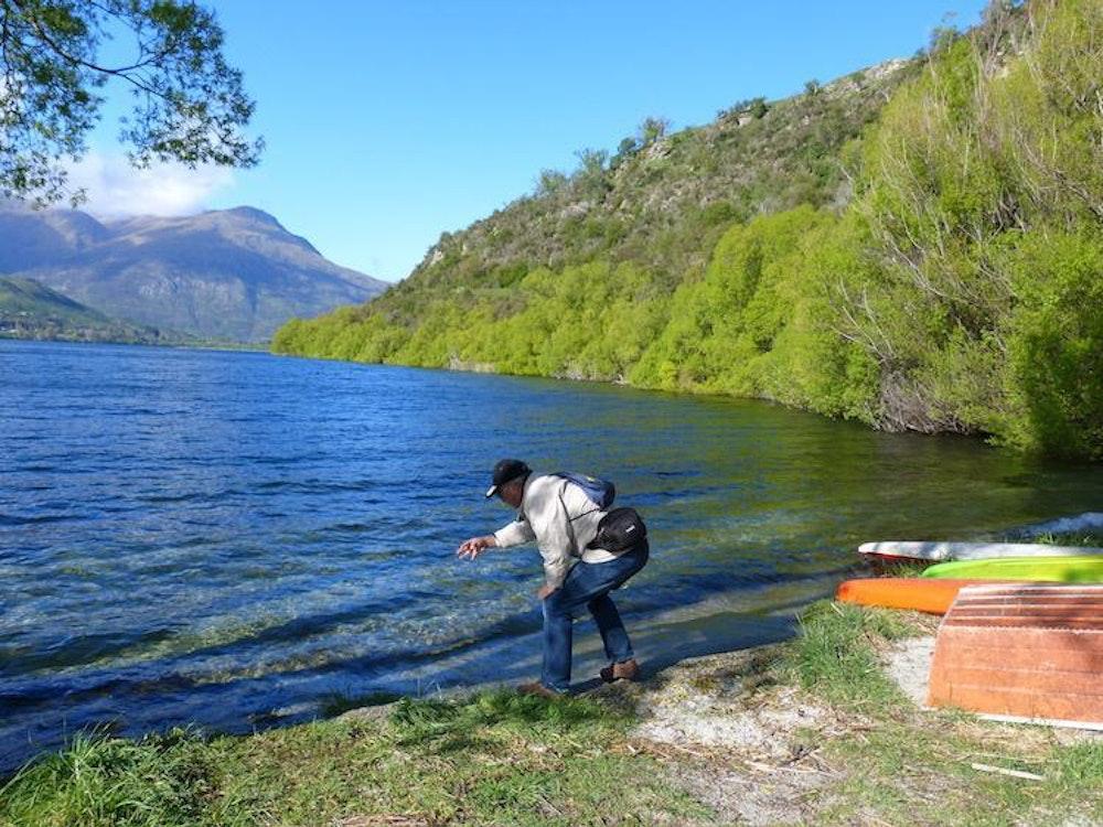 Skimming rocks across the lake, Makarora